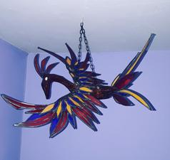 pheonix fire sculpture, snail sculpture, stained glass, unique, snail sculpture, stained glass, antique stained glass,